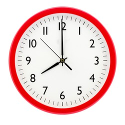 Clock with red round frame on white isolated background shows 8(20) hours 00 minutes
