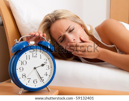 Clock with sleep at night. Woman can not sleep.