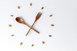 clock, wood spoon and fork clock, bamboo cutlery, almond nuts, almonds, clock on white background, lunch time breakfast time, meal time, healthy eating, eco-friendly, eco-friendly