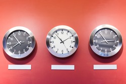 Clocks on the wall showing different time zones.