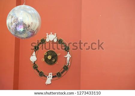 clocks on wall and lightball