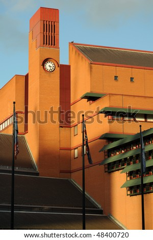 Clocktower of the British Library, Euston, London, England, UK, catching the warm late afternoon winter sun