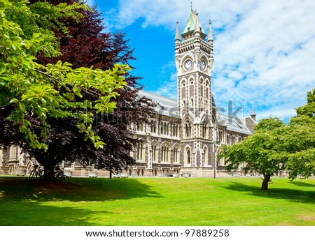 Clocktower of University of Otago Registry Building in  Dunedin, New Zealand - stock photo