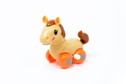 Clockwork plastic toy yellow horse