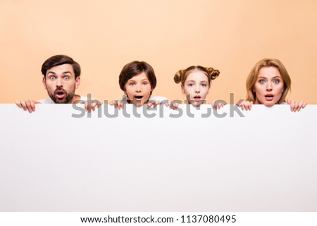 Cloesup portrait of adorable attractive beautiful family, bearded father, blonde mother, boy and girl holding white copy space in front