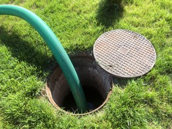 Clogged septic tank. Emptying the septic tank