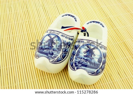 Clogs or wooden shoes, traditional Dutch footwear. Used by farmers. With a general print of a windmill and tulips.