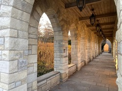 Cloistered stone archway of a suburban Chicago church at sunset during the winter solstice.