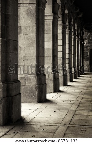 Cloisters of an ancient monastery - stock photo