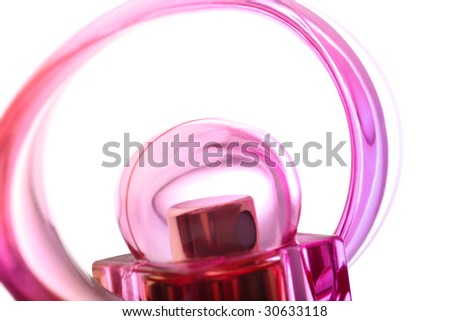 Close abstract detail of red and pink female perfume flacon on white