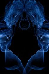 Close blue smoke swirling lines in very dark back ground