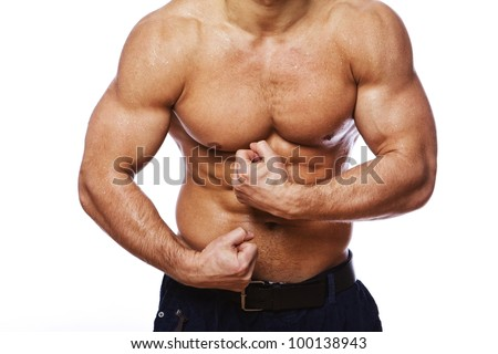 Close image of muscle man posing in studio