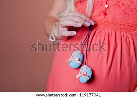 Close image of pregnant woman with boots