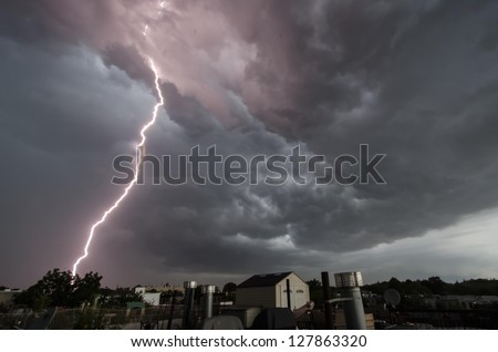 Close lightning strike over Brooklyn rooftops.