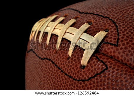 close of a football on black background