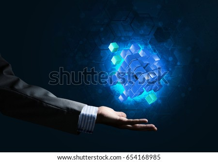 Close of businessman hand holding cube figure as symbol of innovation. 3D rendering #654168985