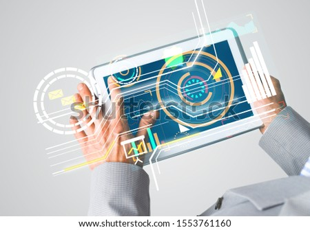 Close of businessman hands holding tablet pc with infographs on screen #1553761160
