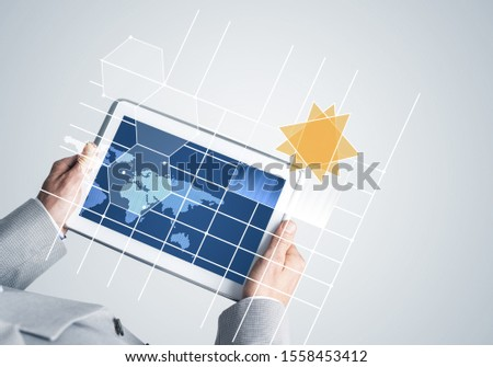 Close of businessman hands holding tablet pc with infographs on screen #1558453412