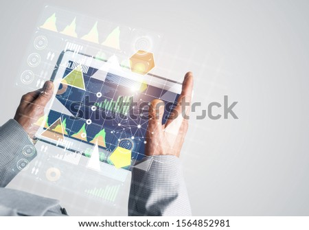 Close of businessman hands holding tablet pc with infographs on screen #1564852981