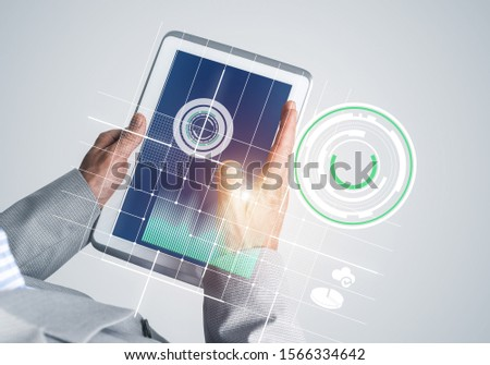 Close of businessman hands holding tablet pc with infographs on screen #1566334642