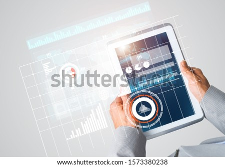 Close of businessman hands holding tablet pc with infographs on screen #1573380238