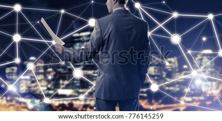 Close of businessman holding papers in hand and connection lines at background #776145259