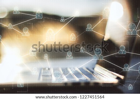 Close of laptop with digital business interface on blurry background. Computing and communication concept. Double exposure  #1227451564