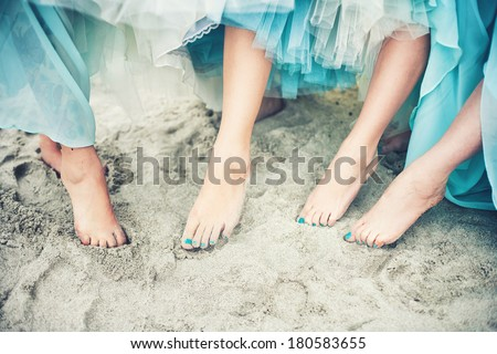 Close of of feet of a bride and her bridesmaids