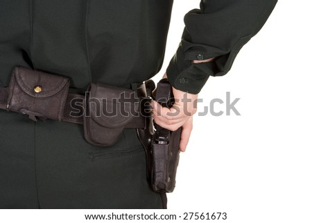 Close of of policeman's hand on his gun.