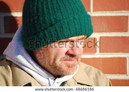 close of unemployed middle age homeless man