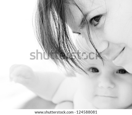 Close portrait of mother and baby