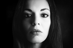 Close portrait of woman. Black and white photography.