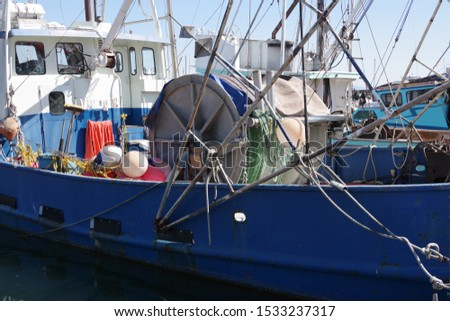 Close sectional full frame view of a fishing trawler docked in a harbor