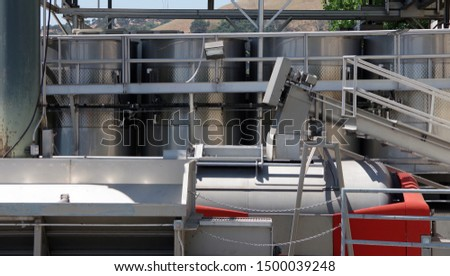 Close sectional full frame view of wine production technology in the northern California wine country