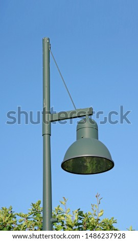 Close sectional upwards view of a public street lamp shaped like a bell