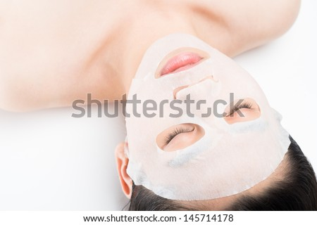 Close-shot of a female face having spa procedure isolated on white