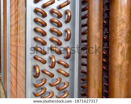 Close shot of copper plain tubes of a condenser coil. ストックフォト ©
