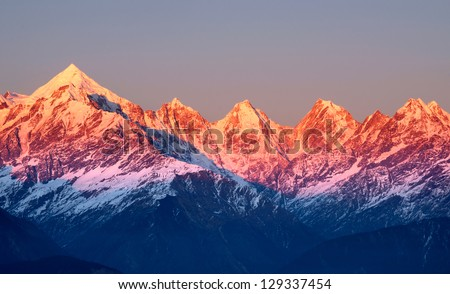 close shot of reddish mountain peaks during sun set