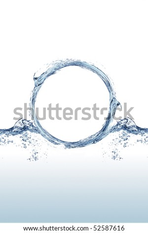 "Close shot of water splashing in the shape of an ""O"" - stock photo"