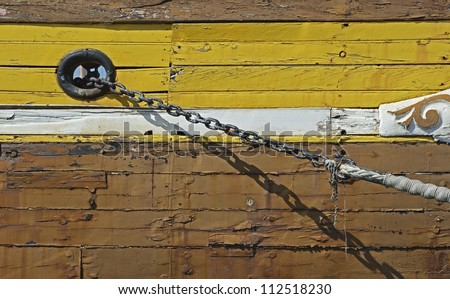Close to a anchor chain of a historic sailing ship in the harbor of Marseille in South France - stock photo