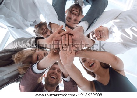 close up. a group of young business people showing their unity.