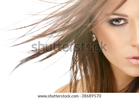 Close up - a half of face of beauty with flying hair, isolated - stock photo