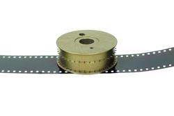 Close-UP a holizontal veiw of the 16 mm film brass sprocket on a film base.