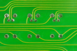 Close-Up a lead solder a pin of a LED and a transistor on a pcb borad.