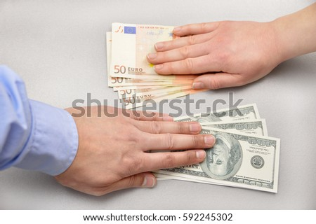 close up a money changing hands of people at bank