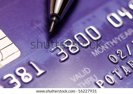 Close-up a pen over credit card