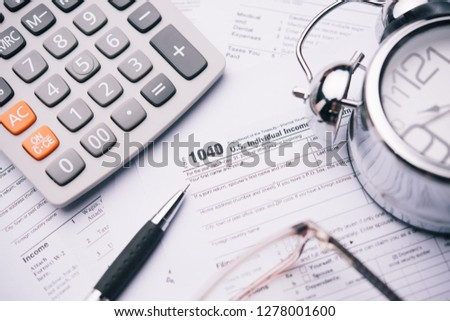 Close up a pen with Tax forms 1040. tax time concept