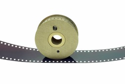 Close-UP a vertical front veiw of the 16 mm film brass sprocket on a film base.