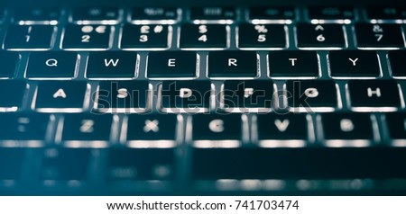Close up, abstract image of a laptop, computer keyboard. #741703474