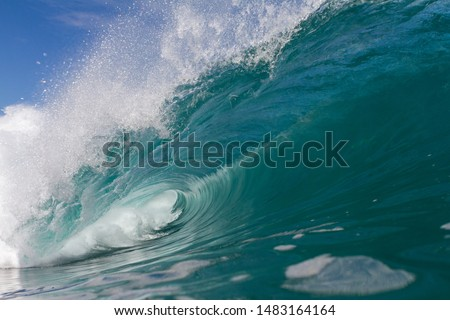 close up action of a wave breaking over a shallow reef #1483164164